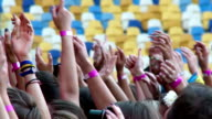 Waving and clapping hands of fans at a rock concert video
