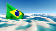 Waving Brazil flag on white sands desert background video