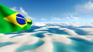 Waving Brazilian flag on desert background video