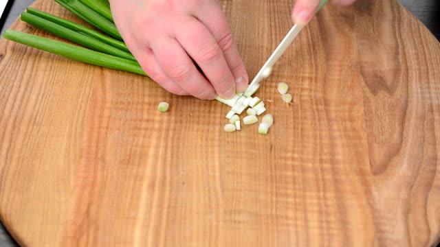 We cut onions on a board. video