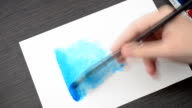 We draw the house on a blue background. video