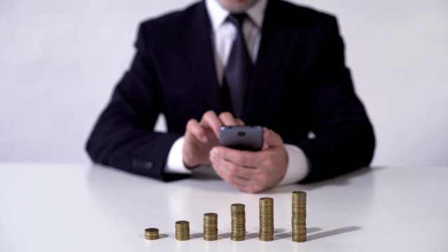 Wealthy man checking news on gadget, financial income from investment growing video