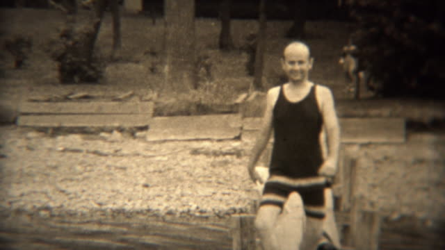 1938: Wealthy man walking on lake dock in hilarious 30s style swimwear. video