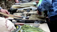 Weapons, Automatic Machines, Grenades, Ammunition, Bullets are on the Table, and Military video