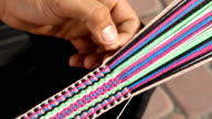 Weave a belt of multi colored threads video