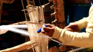 Weaving a traditional scarf. video