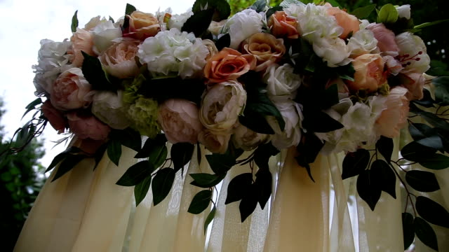 wedding arch decorated with flowers video