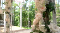 Wedding arch with flowers. video
