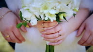 Wedding bouquet in hands of newlyweds video