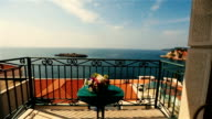 Wedding bouquet with spring flowers on table on the terrace with sea view of Montenegro, Budva video