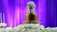 wedding cake decorated with flowers at wedding ceremony video