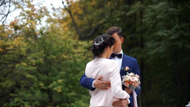 Wedding couple in autumn park video