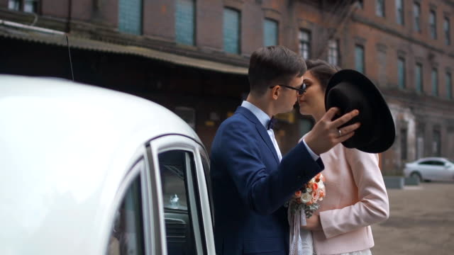 Wedding Couple in Love over the Wedding Car video