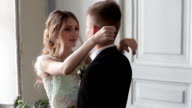 Wedding couple indoors is hugging each other video