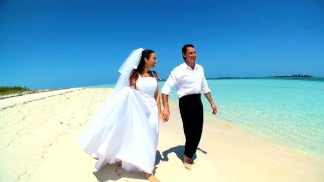 Wedding Couple Laughing & Dancing on the Beach video