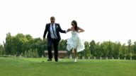Wedding couple running in slow-mo. video