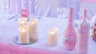 Wedding decor on the table candle and two bottles video
