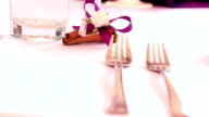 Wedding decorated table with glasses and cutlery video