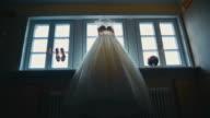 wedding dress hanging on the window video