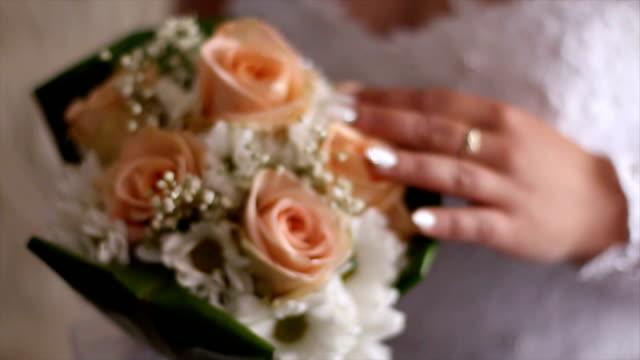 Wedding flowers in bride's hands video