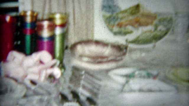 1964: Wedding gifts laid out on the table of kitchen and domestic home goods. video