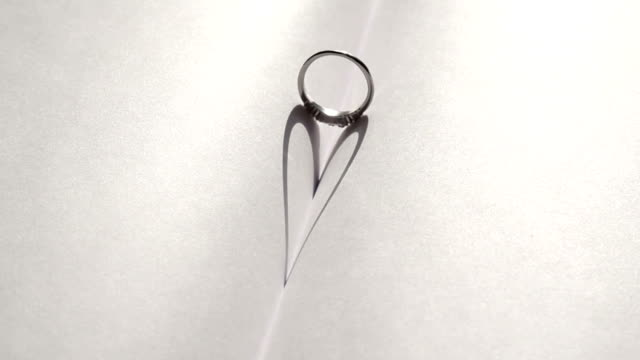 Wedding ring casting a heart-shaped shadow video