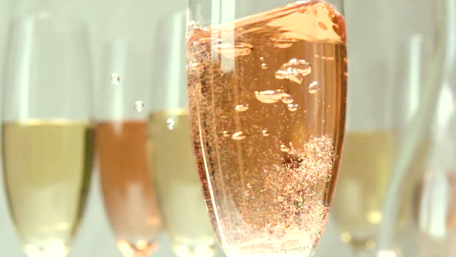 Wedding ring in a glass slow mo video