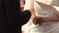 Wedding Ring is placed on Bride's finger during Vows ceremony video
