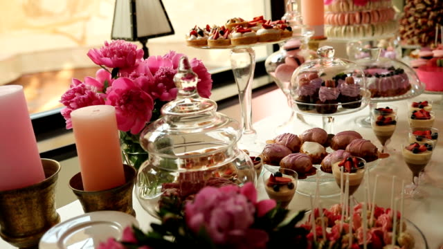 Wedding stylish pink candy bar. Close up. Dolly shot. video