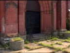 Weeds growing at front door of church video