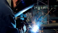 Welder at work in metal industry video