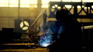 Welder at work in metal industry video
