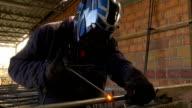 Welder carries out metal arc welding video