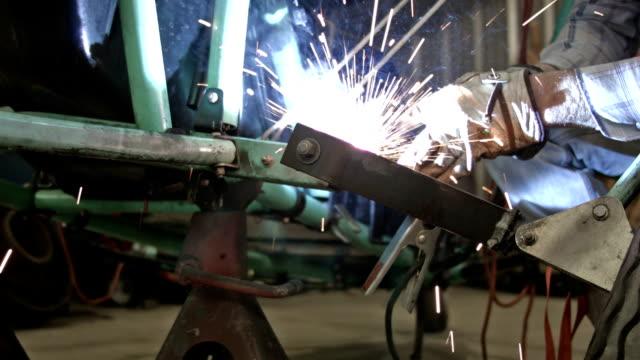 Welder fixing broken vehicle axle repair HD video