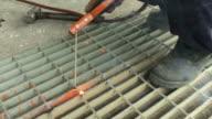 welder welding grating or metal video