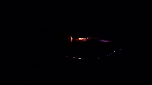 welder welding pipeline at night video