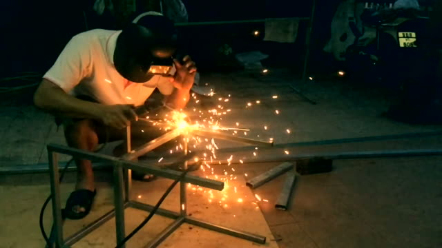 Welder welding structure from high angle view video
