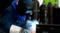 welder with welding sparks video
