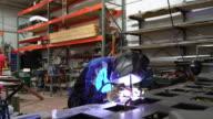 Welder working in a workshop video
