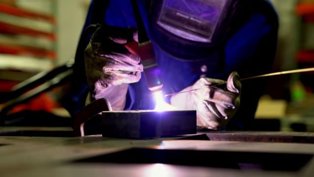 TIG Welder working in a workshop video
