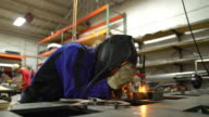 TIG welder working in workshop video