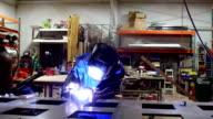 Welder working on metal - SLOW MOTION video