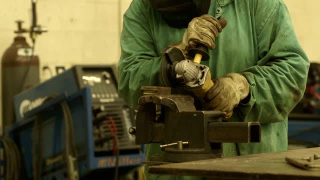 Welder Working with an Industrial Grinder in a Metal Shop video