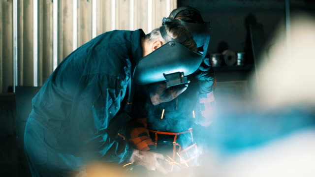 Welders working together 4K video