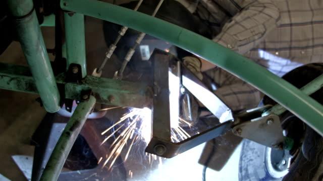 Welding broken vehicle axle HD video
