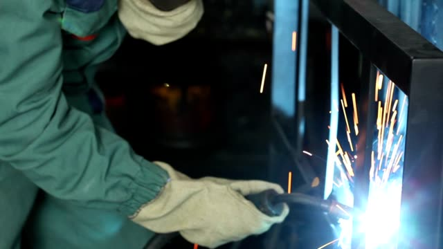 Welding of metal, welding process of metal, welding, close-up video