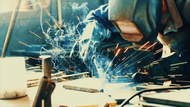 Welding two steel tubes in slo mo. video