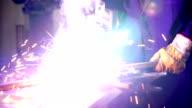 Welding two steel tubes. video