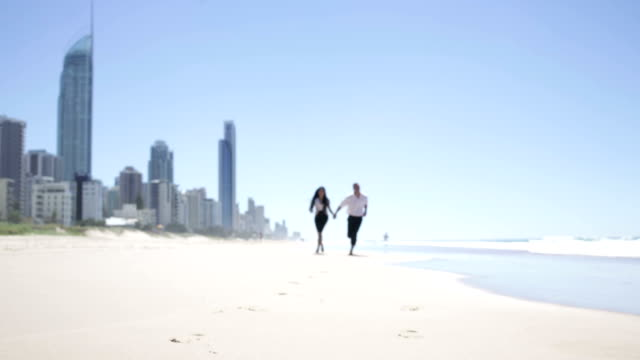 Well Dressed Young Couple Running on the Beach video