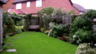 Well kept, enclosed domestic garden with high fence and shed video